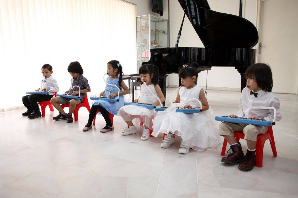 toddlers playing music
